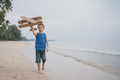 Little boy playing with cardboard toy airplane on the beach - PhotoDune Item for Sale