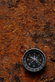 Magnetic compass on rough rusty background - PhotoDune Item for Sale