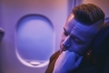 Passenger sleeping during night flight - PhotoDune Item for Sale