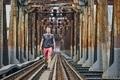 Traveler walking on railway bridge - PhotoDune Item for Sale