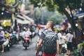 Traveler walking on busy street - PhotoDune Item for Sale