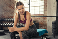 Fitness woman eating energy bar at gym - PhotoDune Item for Sale