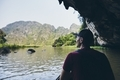 Man on boat floating through to cave - PhotoDune Item for Sale