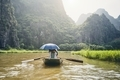 Boat with tourists against karst formation - PhotoDune Item for Sale