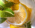 Macro photo of fresh lime and lemon slices with bubbles in the glass. Summer cold drink - PhotoDune Item for Sale