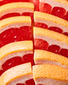 Fresh slices of ripe grapefruit presented in a row. Healthy Diet Fruit. Flat lay - PhotoDune Item for Sale