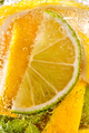 In a clear glass mint leaf, slices of lime and lemon with bubbles. Macro photo of summer drink - PhotoDune Item for Sale