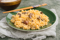 Homemade rice stew on plate and green stage - PhotoDune Item for Sale