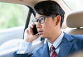 Businessman talking on the phone in car - PhotoDune Item for Sale