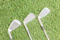 Row of golf club on grass_-4 - PhotoDune Item for Sale