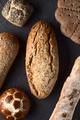 top view of group of rustic breads on dark background - PhotoDune Item for Sale