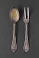 old scratched silver spoon and fork arranged in gray background - PhotoDune Item for Sale