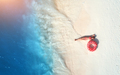 Aerial view of woman with swim ring on the sandy beach - PhotoDune Item for Sale