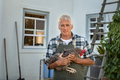 Senior farmer holding hen at farm - PhotoDune Item for Sale