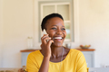 Woman laughing while talking on phone - PhotoDune Item for Sale