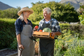Couple of farmers holding vegetable basket - PhotoDune Item for Sale