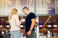Beautiful couple standing in a airport - PhotoDune Item for Sale