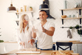 Beautiful couple prepare food in a kitchen - PhotoDune Item for Sale