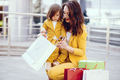 Mother and daughter with shopping bag in a city - PhotoDune Item for Sale