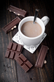 cup of coffee with pieces of chocolate on dark classic wood - PhotoDune Item for Sale