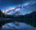 Milky Way over mountains and Antorno lake at night - PhotoDune Item for Sale