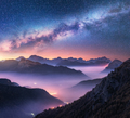 Milky Way over mountains in fog at night in summer. Landscape - PhotoDune Item for Sale