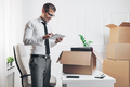 Businessman moving into a new office - PhotoDune Item for Sale