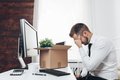 Businessman clearing his desk after being made redundant - PhotoDune Item for Sale