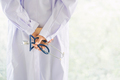 back view of doctor hand hold stethoscope with blur background - PhotoDune Item for Sale