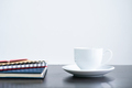 Coffee cup and notebook on desk - PhotoDune Item for Sale