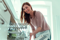 homework woman on dish washer - PhotoDune Item for Sale