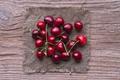 aerial view of ripe cherries on wood - PhotoDune Item for Sale