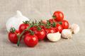 Cherry tomatoes and garlic over  jute fabric - PhotoDune Item for Sale