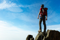 Climber arrive on the summit of a mountain peak. Concepts: victo - PhotoDune Item for Sale