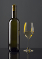 Spanish wine bottle and full glass on black glass - PhotoDune Item for Sale