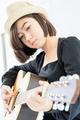 Close up woman playing guitar_ - PhotoDune Item for Sale