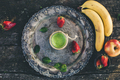 Fresh green smoothie on rustic saucer. On top perspective. - PhotoDune Item for Sale