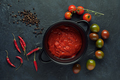 tomato sauce and chili peppers on textured background - PhotoDune Item for Sale