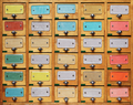 Vintage wooden cabinet with multicolor labels - PhotoDune Item for Sale