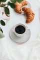 Cup of black coffee with croissant on white  table - PhotoDune Item for Sale