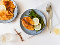 Roasted tilapia fish with asparagus on a ceramic plate - PhotoDune Item for Sale