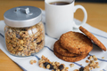 wholemeal oatmeal cookies stack with granola and coffee on napkin - PhotoDune Item for Sale