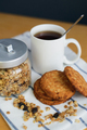 wholemeal oatmeal cookies stack with granola and tea on napkin - PhotoDune Item for Sale