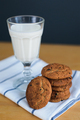 cookies stack with raisins and milk on napkin on table - PhotoDune Item for Sale
