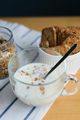 milk and cereals flakes in glass cup with granola and wholegrain cookies - PhotoDune Item for Sale