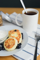 fried circular syrniki, tvorozhniki or cheese cake with sour cream and hot drink - PhotoDune Item for Sale