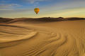 Hot Air Balloon in the desert at sunset background - PhotoDune Item for Sale
