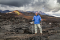 Young traveler on a background of volcanic rock. Kamchatka. - PhotoDune Item for Sale