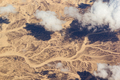 Clouds over a desert landscape. View from the airplane window - PhotoDune Item for Sale