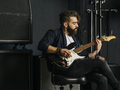 Bearded man playing guitar in a music studio - PhotoDune Item for Sale